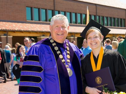 President Cureton and a graduating student