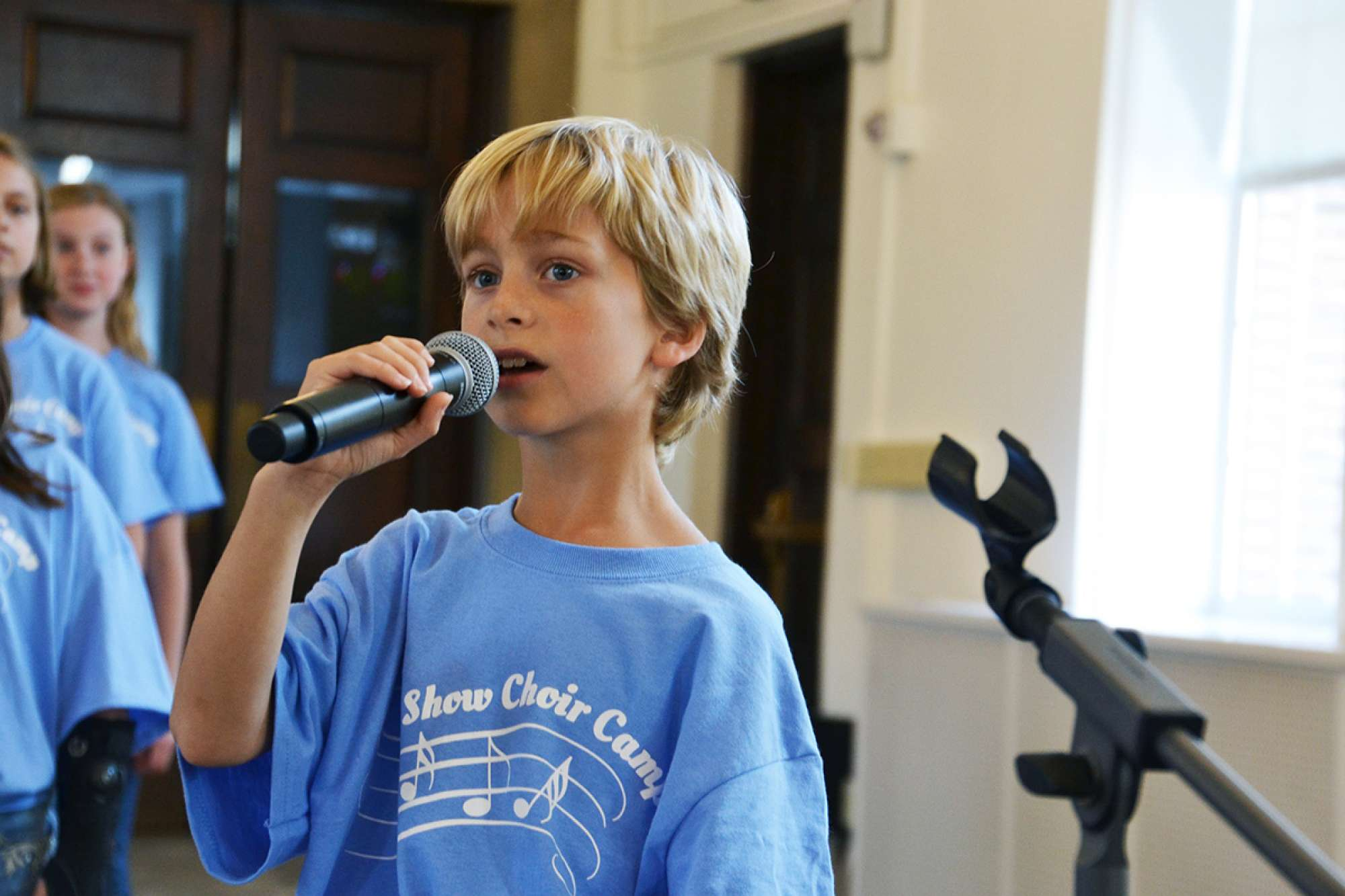 Boy singing with a microphone
