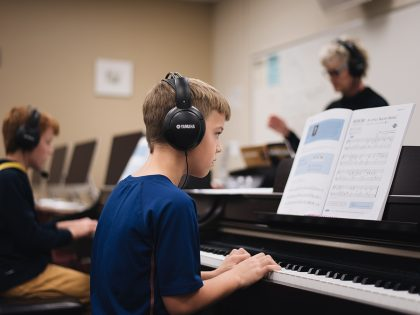 Two students having piano lesson
