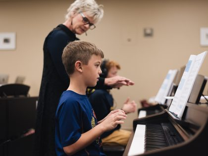 Instructor with students at piano