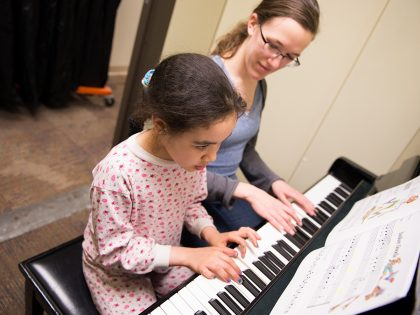 Student and instructor at piano