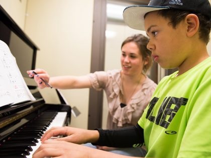 Piano student and instructor