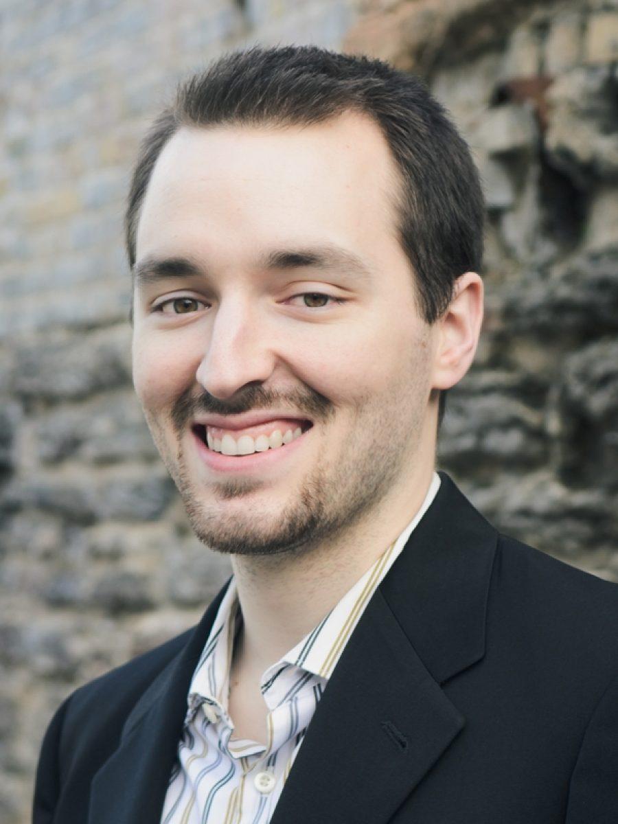 Portrait of Joel Alexander