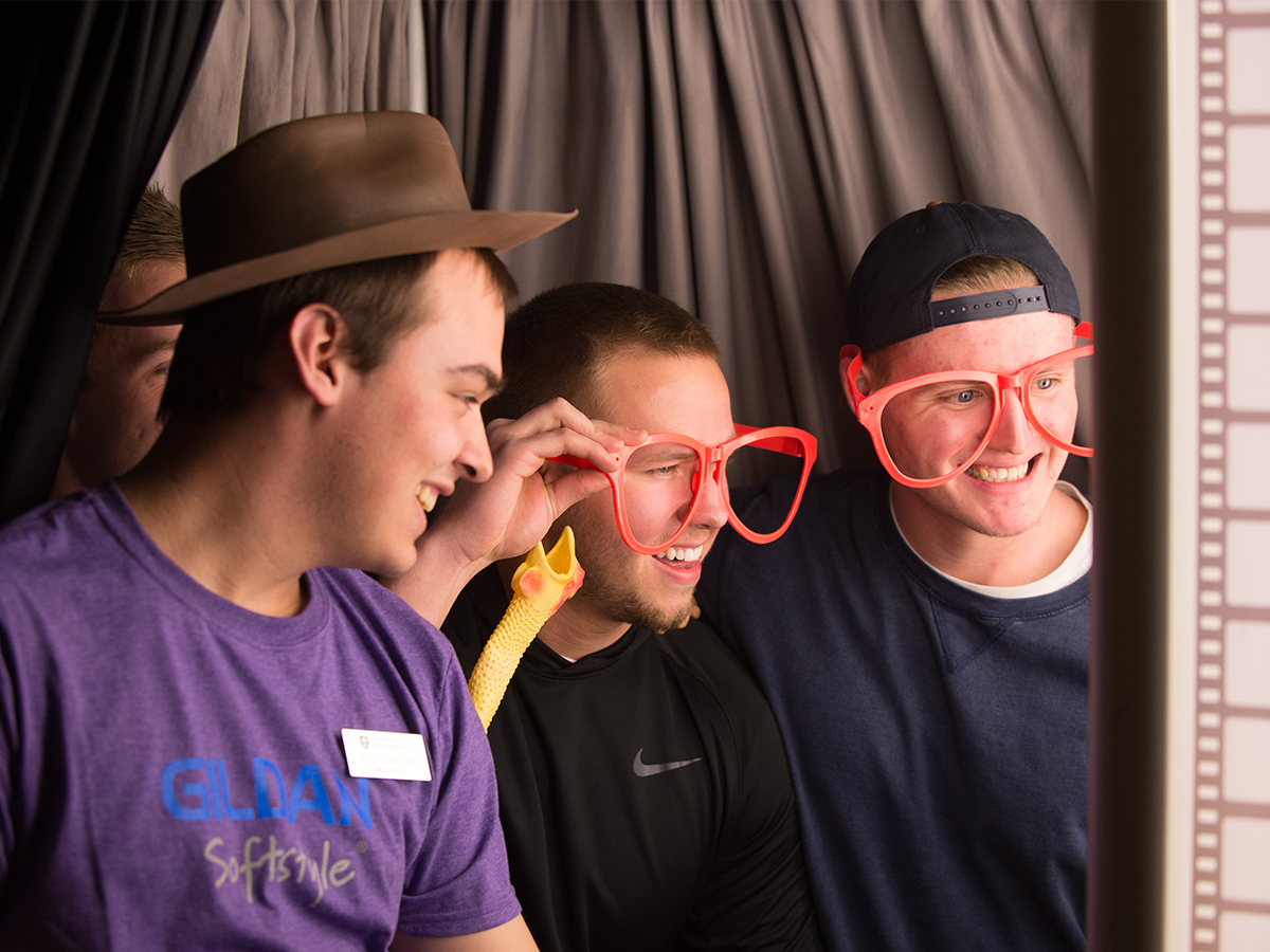 students in a photobooth at Icebreaker