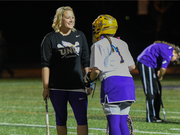 player talking to lacrosse coach Deetjen