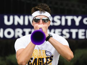 Northwestern student blowing horn