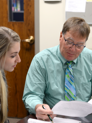 Professor Philip Vierling helping a student.