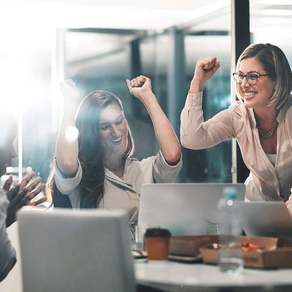 Professionals celebrating success in the office