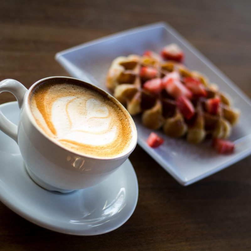 Photo of coffee and a waffle