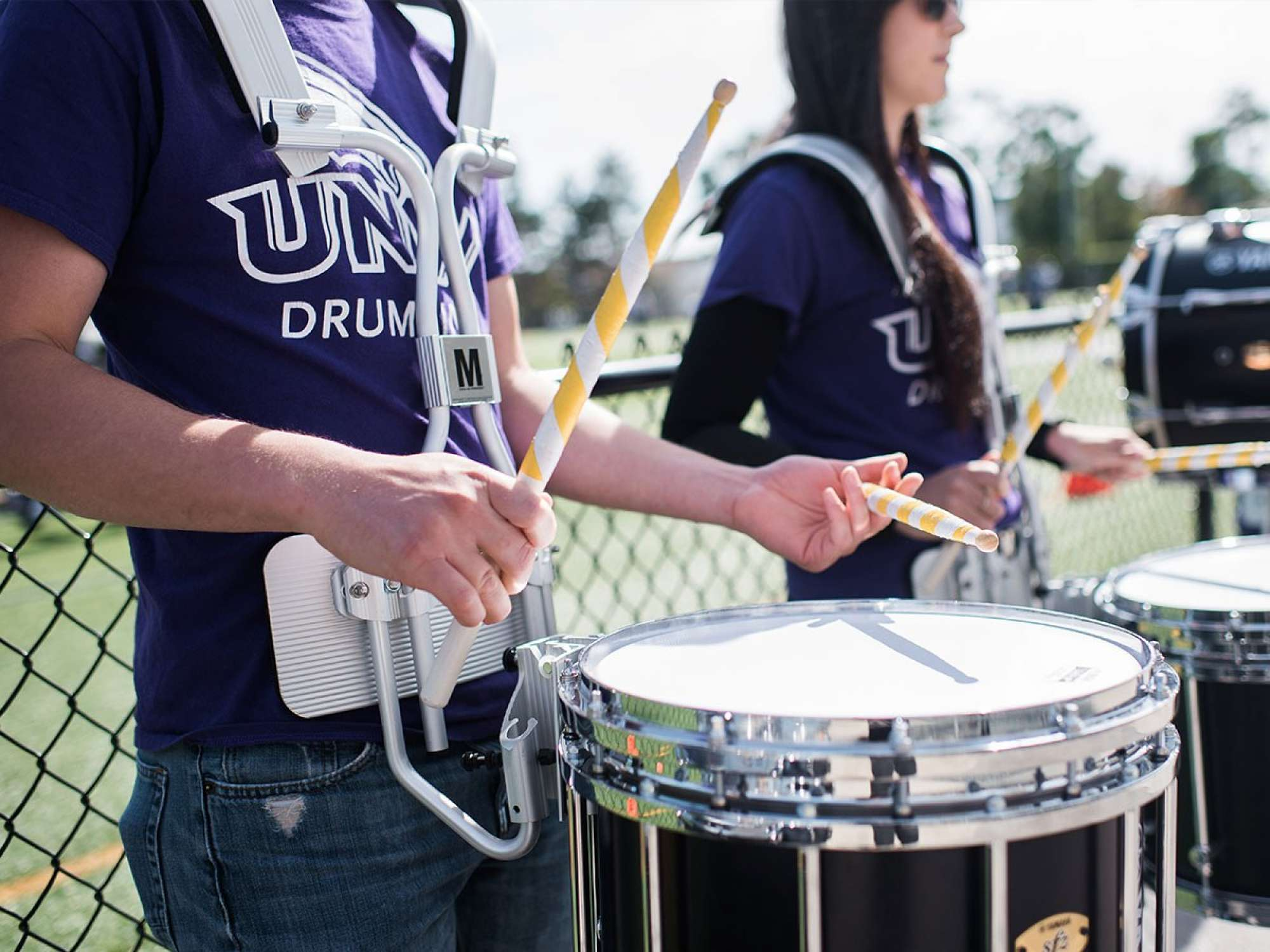 UNW Drum Line performing at a homecoming game