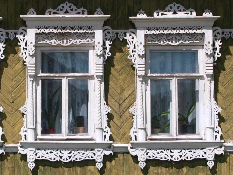 Two ornate Russian windows painted white