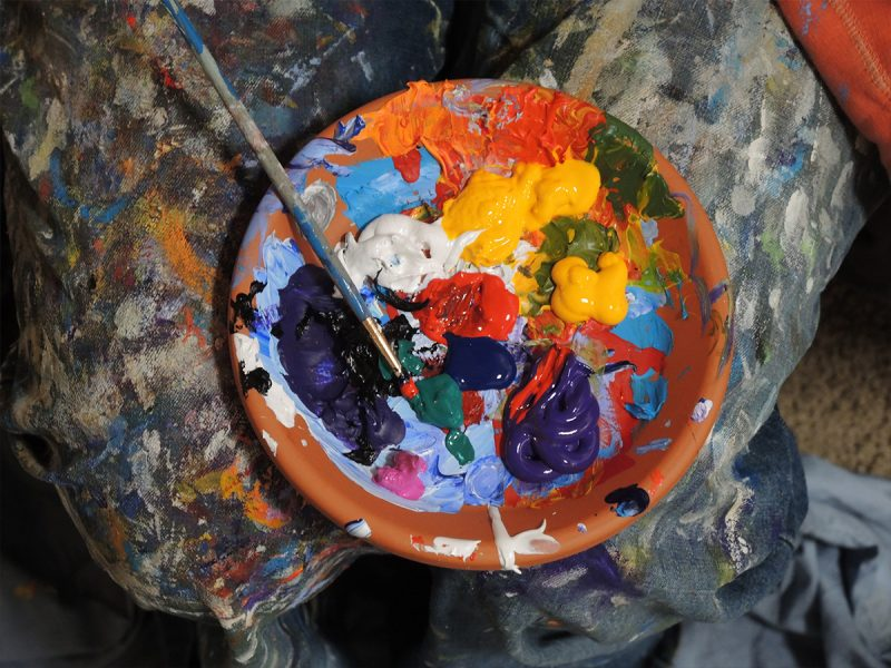 Bowl of paint with paint brush