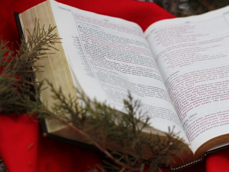 Bible with Christmas decorations around it