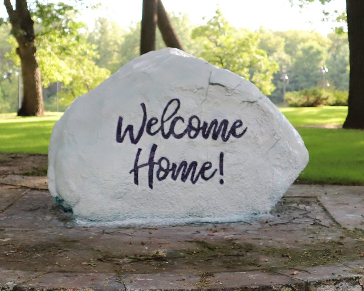 "the rock with the words ""Welcome Home!"" on it"