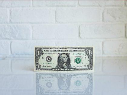 Singel dollar bill on desk