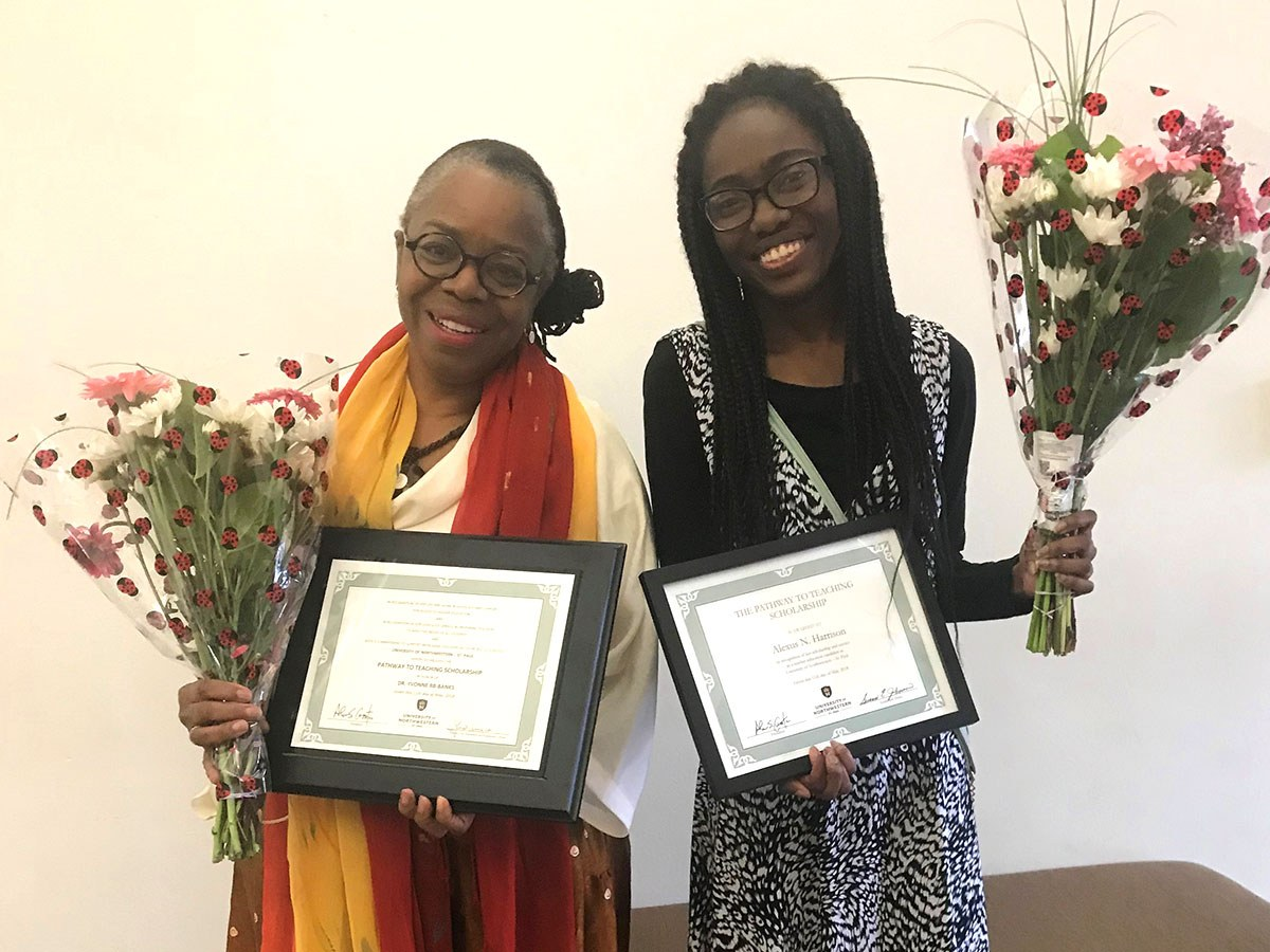 Yvonne RB-Banks Ph.D. and Alexus Harrison holding awards for the Pathway to Teaching Scholarship honors.