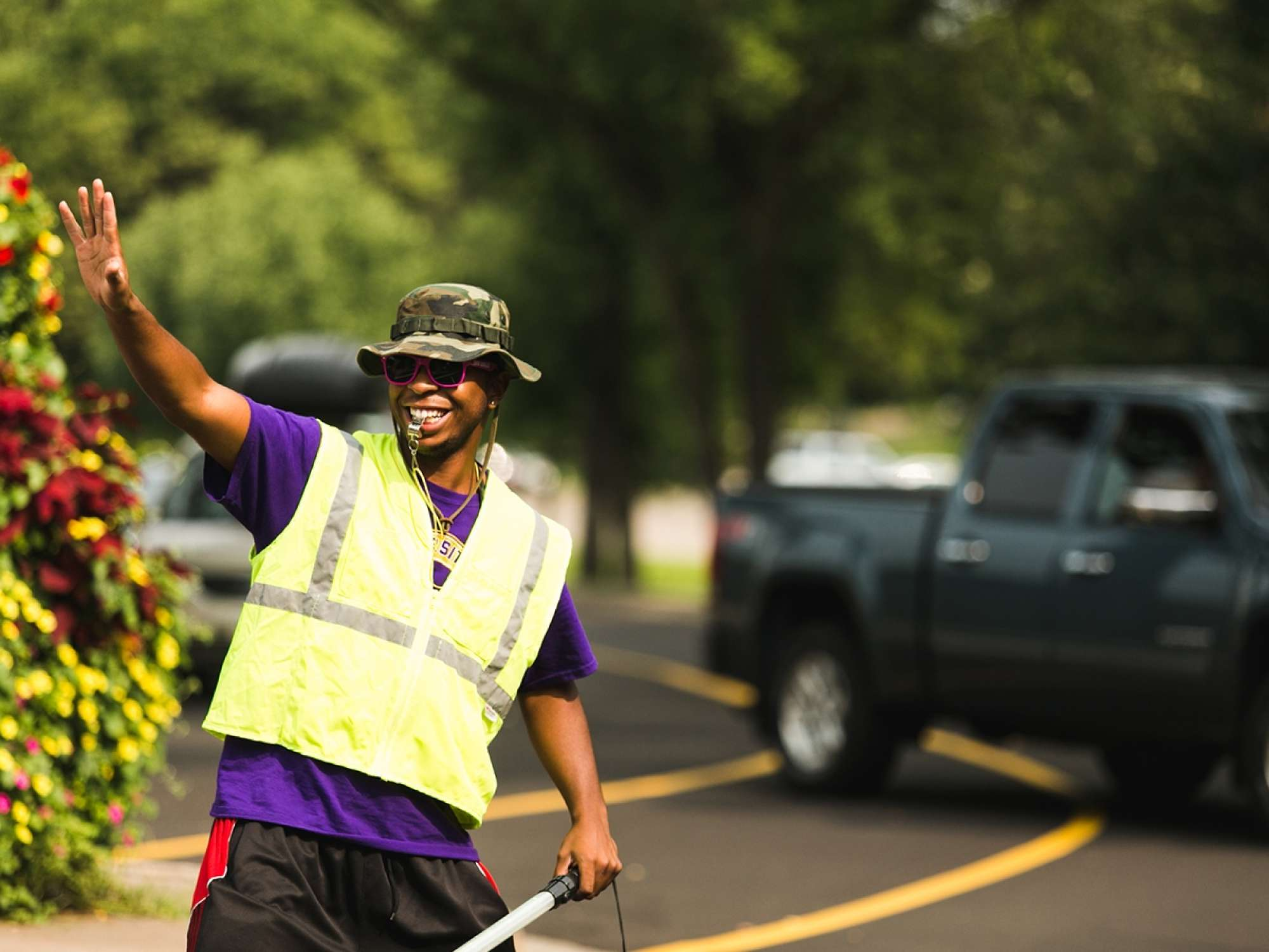 Crossing guard smiling and waving