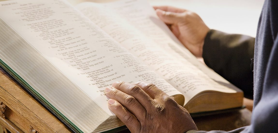 Reading a bible with scripture messages