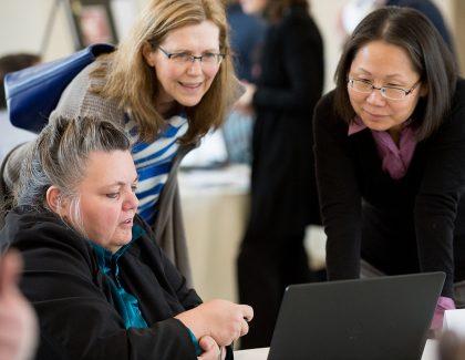 Three women looking at laptop screen