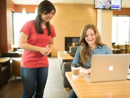 Student on laptop in coffee shop
