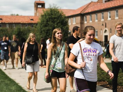 Students and parents walking on campus