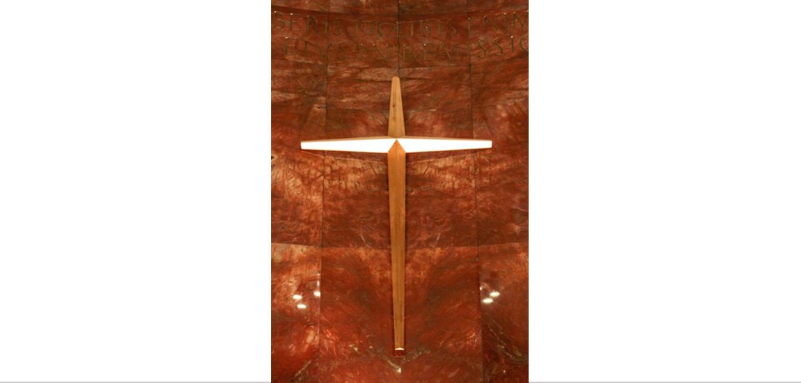 Close up of the wooden cross fastened to the marble walls of Nazareth Chapel