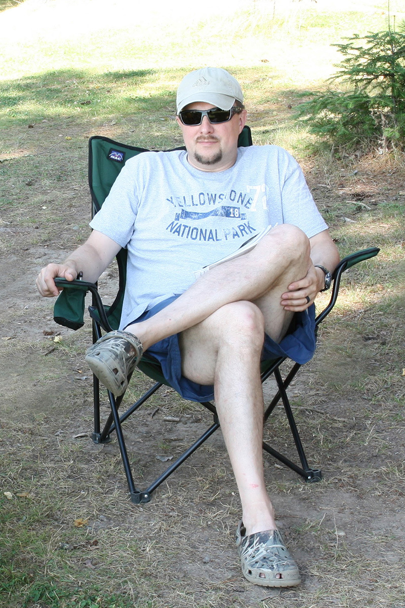 Jeremy Kolwinska sitting in a camping chair