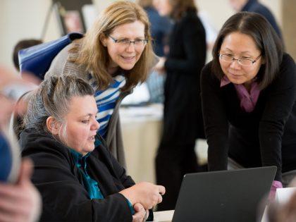Three women looking at a computer screen