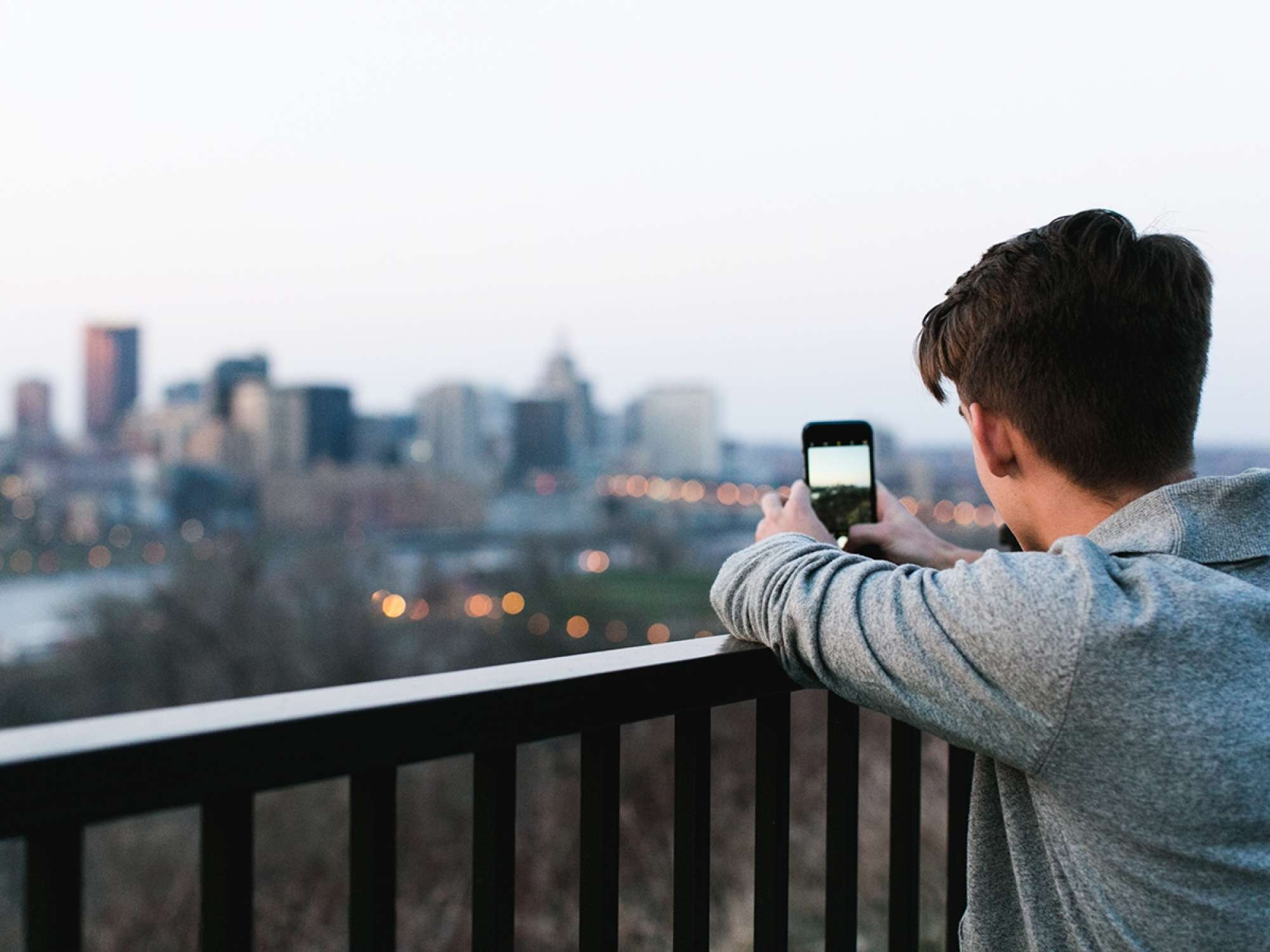 Man taking image of city