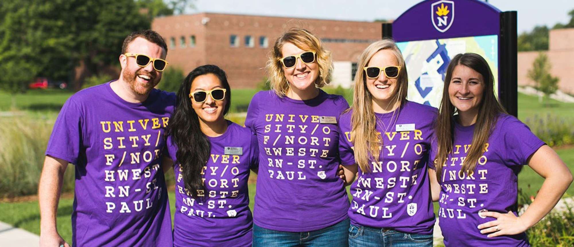 Group of diverse Northwestern Staff welcoming new students.