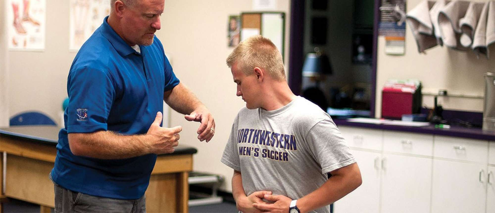 Student athlete working with a trainer.