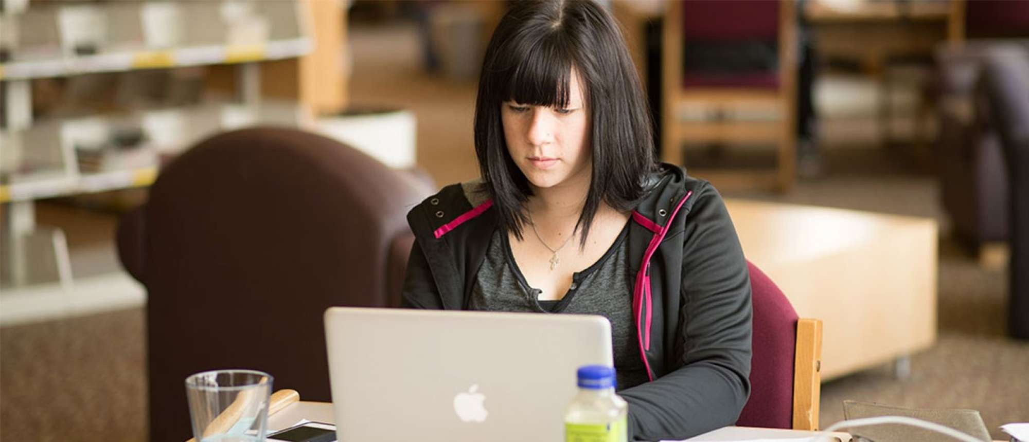 Female student using a laptop computer.