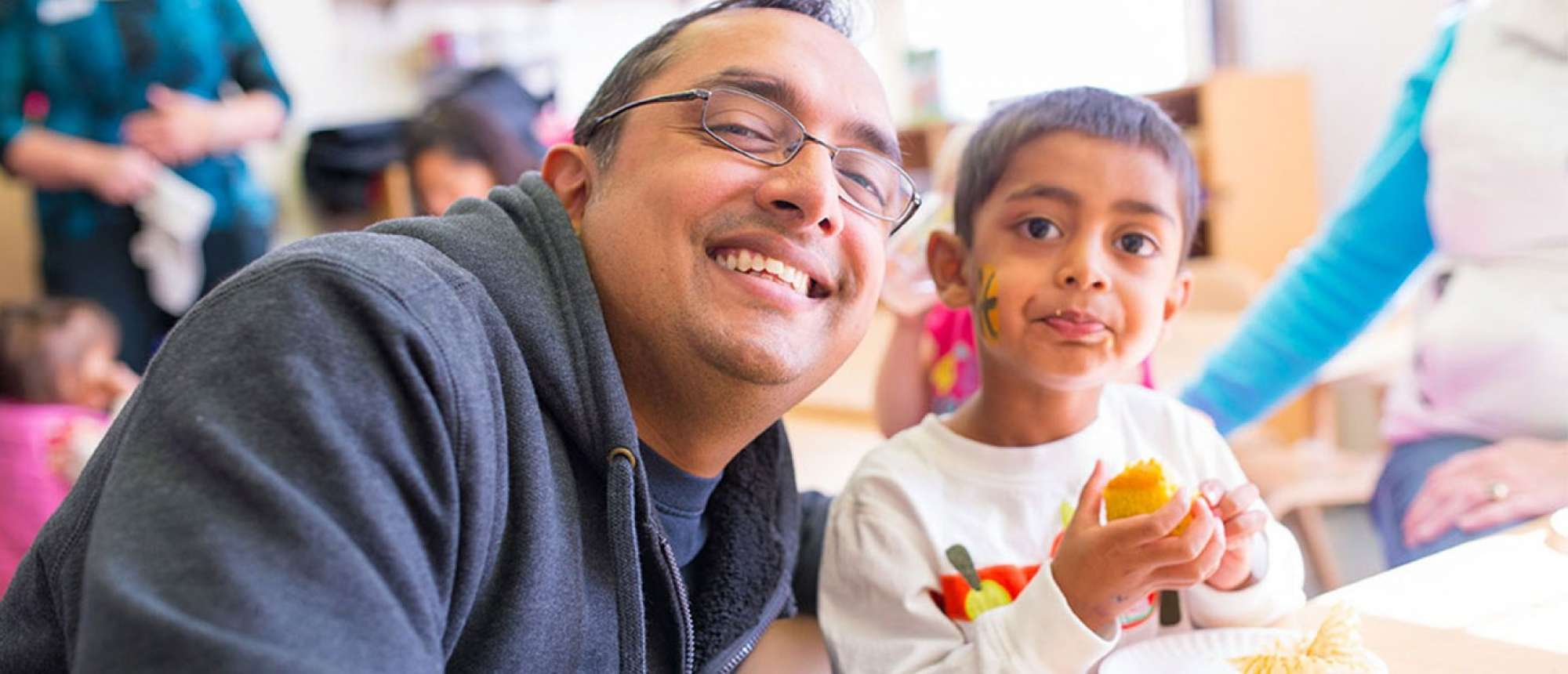 Dad posing with son in the Child Development Center