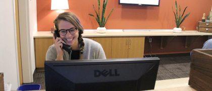 Northwestern Depot student worker on phone