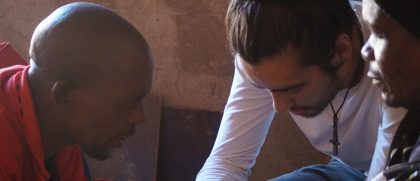 Student praying on a mission trip