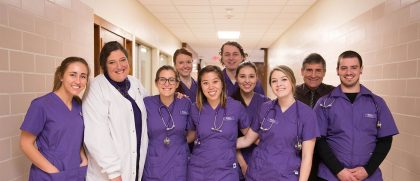 Group of nursing students posing in the hall
