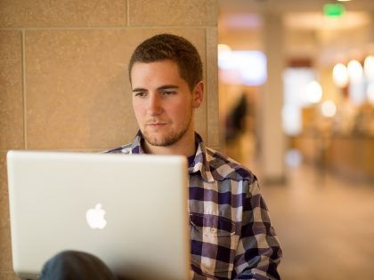 Student on laptop in the Billy Graham Community Life Commons