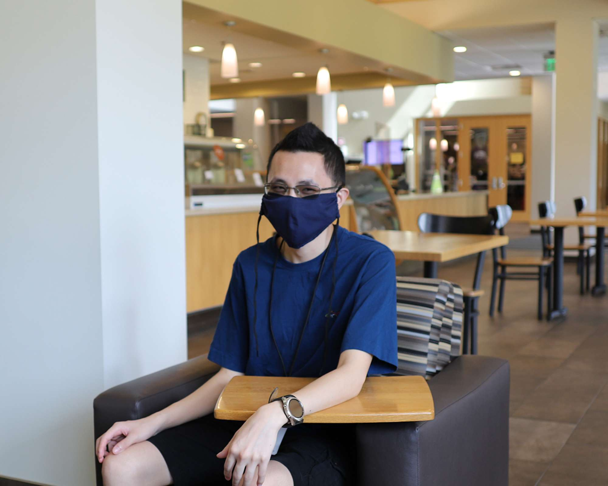 Student in chair wearing a mask