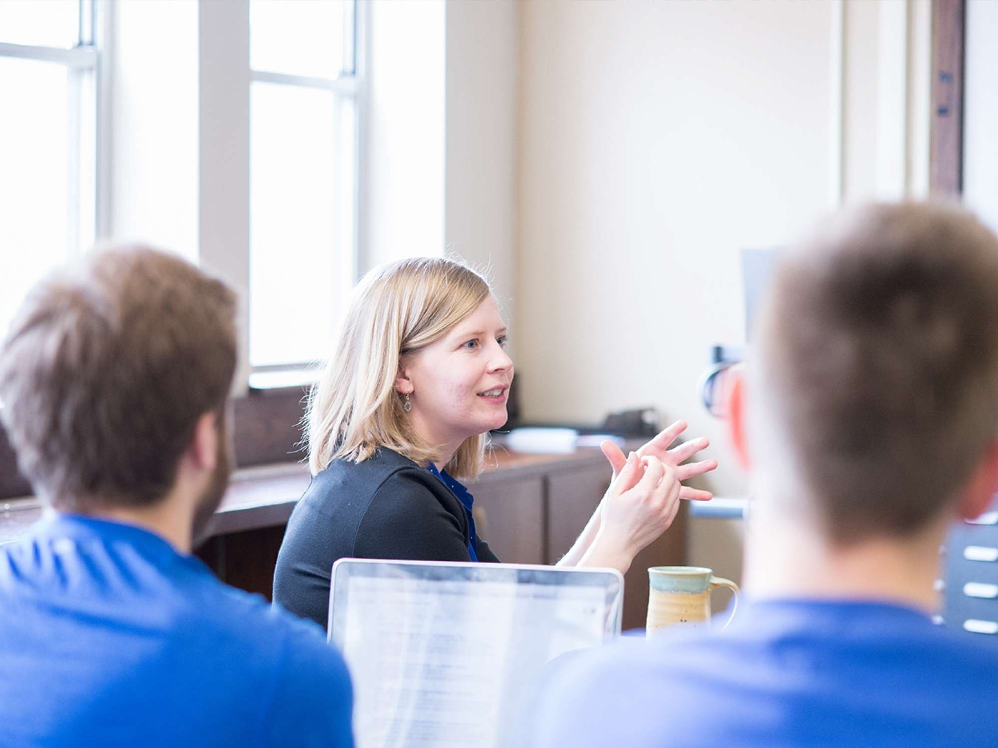 Professor talking to students