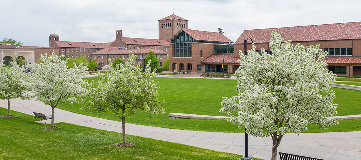 Campus green in the spring with the Billy and Nazareth Hall in the background