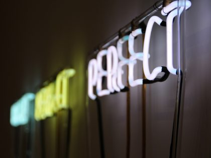 A neon light that says perfect
